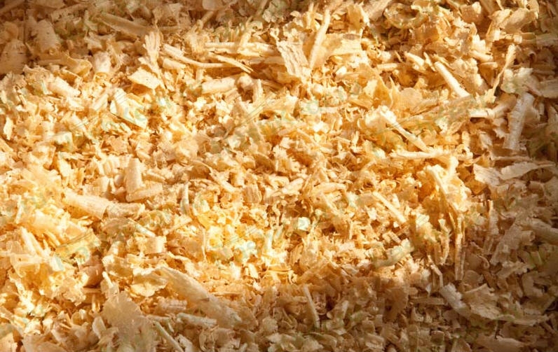 sawdust as plyboard Simply put, particle board is a waste-wood product made by heat pressing wood chips, sawmill shavings, or even sawdust and resin together to make the end product water resistant, fireproof, and/or insect-proof chemicals are used including wax, dyes, wetting agents, and release agents.
